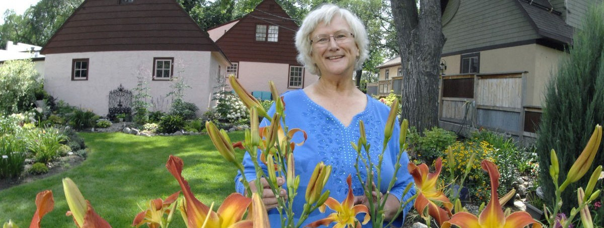 Susan Holland at Storybook Stucco Cottage Gardens. Photo by Bismarck Tribune, ND, 2017